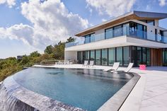 The Montauk Beach House by KATCH I.D. in East Hampton, NY is a contemporary…