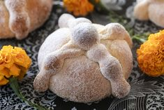 Pan de Meurtos for Day of the Dead | Pan de Muertos, a Mexican sweet roll with a dramatic history, is served along with the favorite foods of lost loved ones for Day of Dead. Whether you intend to celebrate of not, this fluffy, cinnamon crusted bread is a delectable project to tackle in the kitchen | TasteBook