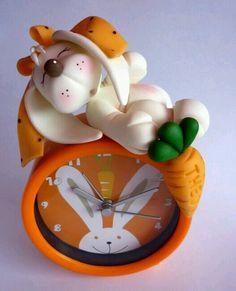 Cojejito en reloj