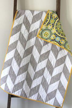 grey and white herringbone quilt.