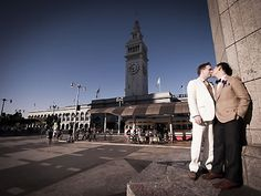 Wedding portraits in front of the San Francisco Ferry Building. Liz Caruana Weddings.