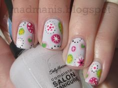Abstract dots.In love with this mani from Mad Manis. I think they look like pretty snowflakes.