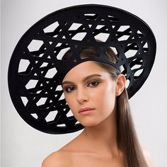 Cane - Based on the weaving pattern of a straw rain hat used in the rice paddy fields of Nagaland, this laser-cut geometric neoprene beret creates a striking silhouette.