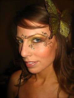 Forest fairy makeup, also love the butterfly in the hair.
