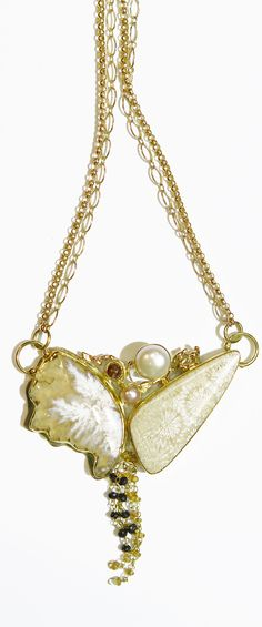 Plume jasper necklace with petrified coral, rose cut diamond, pearl with black diamonds & yellow sapphire chain dripping down; in 22k and 18k gold.  by Jennifer Kalled
