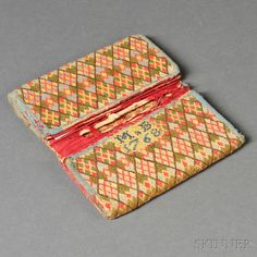 """Wool Needlework Wallet, probably New England, c. 1768, envelope-shaped pocketbook with two dividers, worked in the Irish stitch in a diamond pattern in shades of green, red, blue, and yellow, stitched initials and date """"MxB 1768,"""" with red silk lining, and light blue wool twill tape edging, (losses), folded dimensions 3 1/2 x 6 1/4 in."""