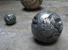 Nicola Costantino -     Hog-balls, 1998.  Cast of hogs in alumininum and polyester resin.  50 cm. diameter.