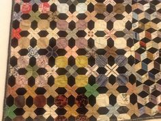 Patricia quilts at home: The Quilt Museum in York (England).   Ridehalgh quilt (plinth) 1860-1890.  Looks like nine-patches and snowballs on point .... maybe.