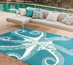Combining hand hooking with hand tufting techniques, the Orange Coral area rug offers a rich, textural surface yet can be used either indoors or outdoors. This tailored pattern of layered orange coral