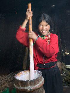 Tibetan Girl Making Butter Tea Inside the Yurt, Dingqing, Tibet