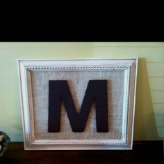 Picture frame with burlap backing and painted initial.