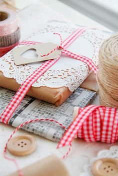 {Kraft Paper Packages Tied Up with String}  The styling and palettes are simply gorgeous! Ths red, white, and Kraft theme, which features a completely awesome red felt coaster as a packaging embellishment, twine and  doilies.