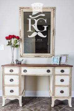 Mirror & Desk / Vanity painted in Annie Sloan Chalk Paint Old White, then clear wax then dark wax.  Top sanded and stained using General Finishes Antique Walnut High Performance