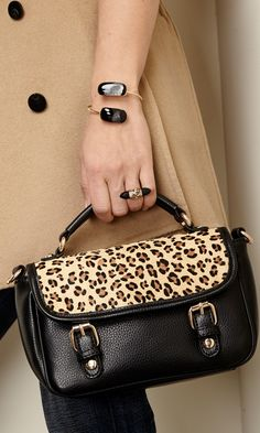 Mini crossbody bag with leopard hair calf front flap, gold-toned hardware and snap closures.