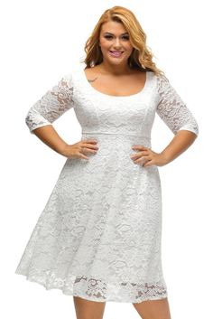 This gorgeous plus size fit & flare dress features a beautiful floral lace fabrication, round neckline with V back, sheer quarter sleeves, and midi-length f