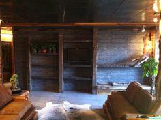 Proyecto Loft Fontova. Arquitecto: María José Bisbal A. Empresa: Nativo Red Wood Decoración de interiores arquitectura rústica, zona living, mueble en obra con chimenea de etanol.