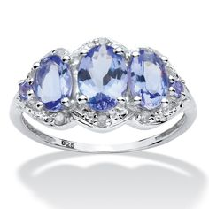 Understated elegance. 1.93 carats T.W. of tanzanite stones are accented with diamonds. This ring can be worn on either h-CJu8aVkL