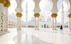 Located in Abu Dhabi, the Sheikh Zayed Grande Mosque Center was built between 1996 and 2007. The entire structure houses 82 marble domes, 1,000 columns, the world's largest chandelier, and the largest hand-knotted carpet.