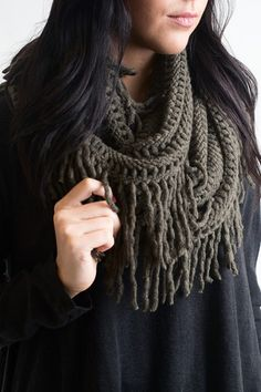 The scarf world is infinite at Single Thread Boutique! We have everything you need and more! This beautiful olive lattice infinity scarf is soft to touch and amazingly detailed. The all around fringe