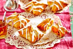 Juicy apricot halves and sultanas coated with brown sugar, stuffed into a golden pastry envelope, and drizzled with a milky, icing sugar topping