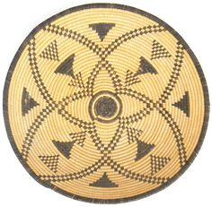 This Yavapai Apache basket has a clean 4 point star which is woven with willow and devil's claw. Description from camerontradingpost.com. I searched for this on bing.com/images