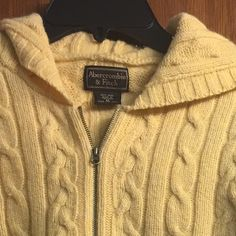 Abercrombie yellow hoodie medium top blouse Good condition If you are interested in buying more than one listing you may let me know and I will create a new bundle listing for you with YOUR suggested REASONABLE price. If you are not sure about purchasing the product please don't buy and then leave a negative feedback. Please see photos and ask questions before purchasing. You are welcome to make offers. Have fun shopping. Abercrombie & Fitch Tops
