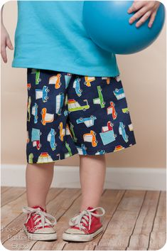 This FREE PDF Sewing pattern includes a pair of basic pull-on shorts and a t-shirt with an optional pocket