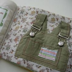 book of snaps, zippers, buckles, etc. using kids' old clothes!