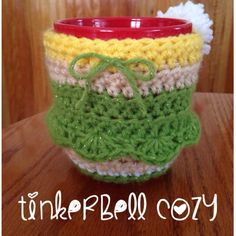 Tinkerbell Inspired Character Cozy  ($12) https://www.etsy.com/listing/190786265/tinkerbell-inspired-character-cozy?
