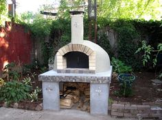 Clay oven...once you've had bread or pizza made in this, you'll want one for your backyard.