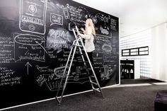 LOOP digital agency. Large chalkboard walls for analogue scribbling, a dedicated brainstorming area and a social area with bistro tables and a soft-ice machine ensure that our team has enough creative space to come up with outstanding ideas.