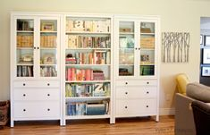 Family room with Ikea Hemnes bookcase with books and accessories Ikea Hemnes Living Room, Ikea Hemnes Bookcase, Bookcase Wall, Bookshelves, Garage To Living Space, Stairs In Living Room, Living Room Seating, Ikea Inspiration, New Home Wishes