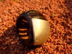 Anel feito artesanalmente em semente de tucumã e metal. Tamanhos  personalizados.
