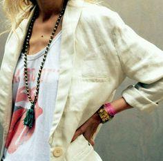 light linen jacket, worn t-shirt, tibetan beads.