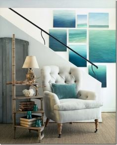 inspired by the sea / a wall of sea paintings and a great circular step stool used as a side table