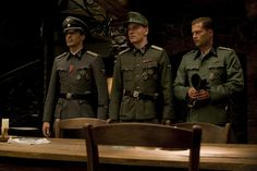 Gedeon Burkhard (Cpl. Wilhelm Wick), Michael Fassbender (Lt. Archie Hicox) and Til Schweiger (Sgt. Hugo Stiglitz) in INGLOURIOUS BASTERDS.