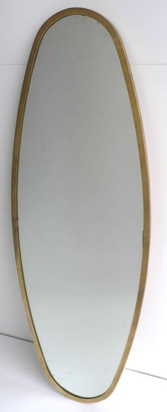 Anonymous; Brass and Glass Wall Mirror, c1950s.