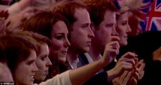Big night out: Eugenie sat next to Beatrice in the young Royals' box, alongside an enthusiastic Kate who never once stopped cheering and smiling