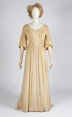 Summer Frock in reforming model of beige silk, some with smocking and embroidery fantasy flowers, carried in the same shade beige silk....Metz & Co (fashion house) Period circa 1910