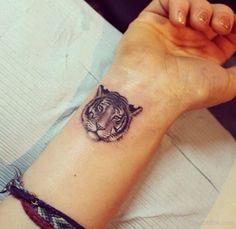 Tiger-Tattoo-On-Wrist.jpg 550×536 pixels