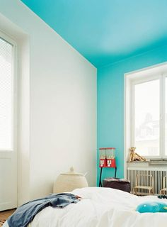 Bright blue color blocking on one wall and ceiling