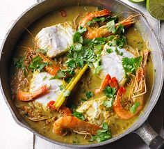 Coconut fish curry: This colourful hake and prawn one-pot has Thai and Indian inspired flavours and is quick enough for midweek - ready in under 30 minutes