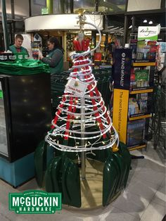 This joyful tree is made from shovels, hose, and a blingy sprinkler head!  www.mcguckin.com