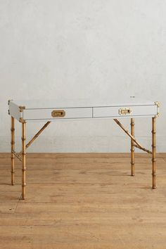 Faux bamboo legs and campaign style drawers. Anthropologie Lacquered Wellington Desk