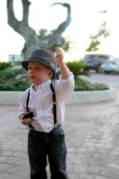 Suspenders, chapeau, and balloon (out of frame).  What more does a fashionable little boy need?
