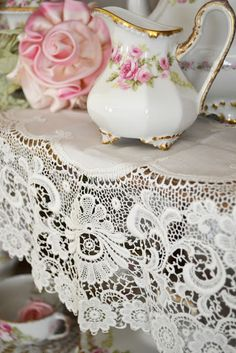 There's just something about white china with a pink floral pattern and a lace backdrop