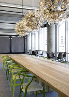 Large conference table with chairs in different nuances of green. Also love the pendants from Flos. Office Space Design, Workplace Design, Office Interior Design, Office Designs, Bureau Design, Corporate Interiors, Office Interiors, Work Cafe, Commercial Office Design