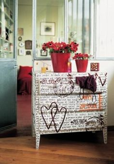 Im really thinking about going in the word direction. In my head Im seeing black body, white top and drawers, then I write all over the drawers like this one. Only without the stamps. dressers