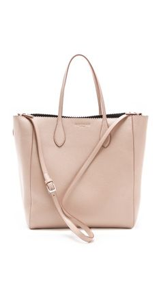 Rochas Textured Edge Tote    in Pastel Pink.  Super-soft, glazed leather forms a classic Rochas handbag, accented with embossed logo lettering. A slim zip pouch is attached to the leather-lined interior, and a shoulder strap clips to the sides. Dust bag included.    Leather: Deerskin.  Weight: 35oz / 0.99kg.  Made in Italy.    MEASUREMENTS  Height: 13in / 33cm  Length: 12in / 30.5cm  Depth: 4in / 10cm  Strap drop: 8in / 20cm