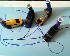 Markers taped to the back of cars for writing!